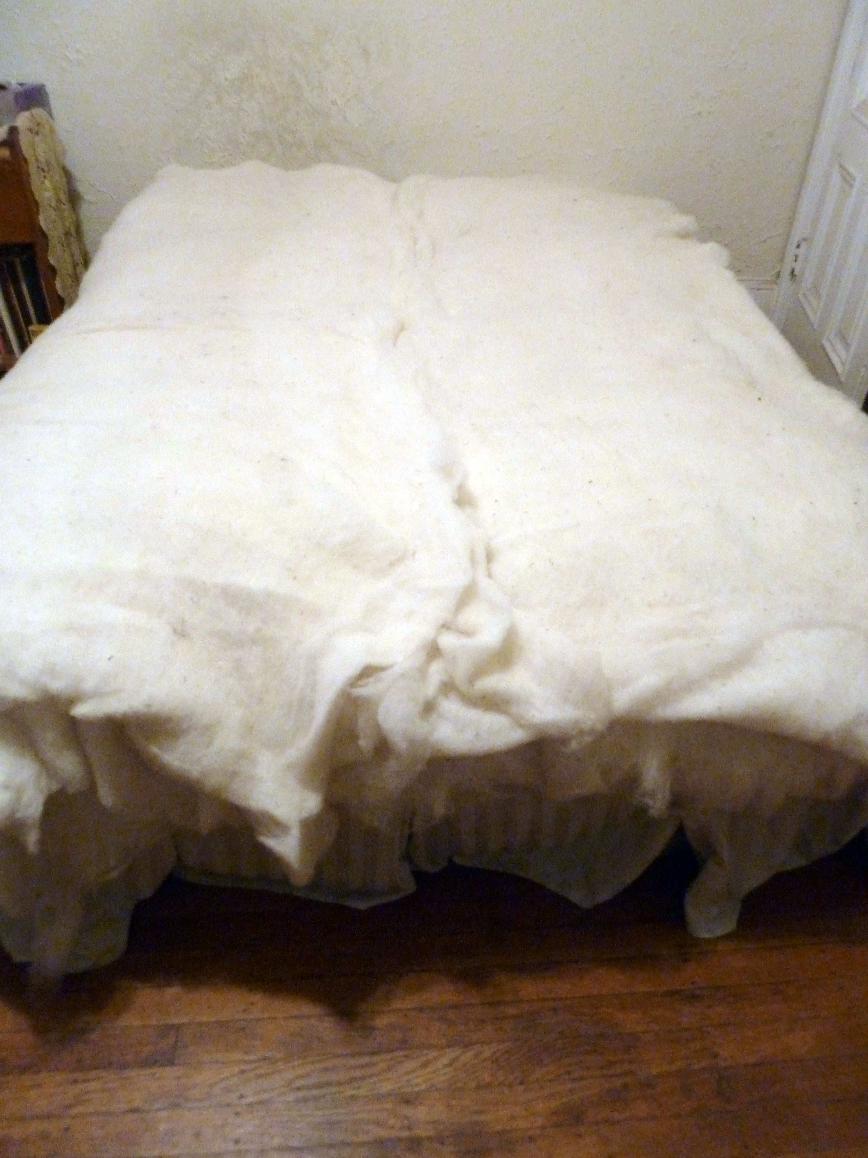 wool batting layers pulled on top of buckwheat hull pillow inserts